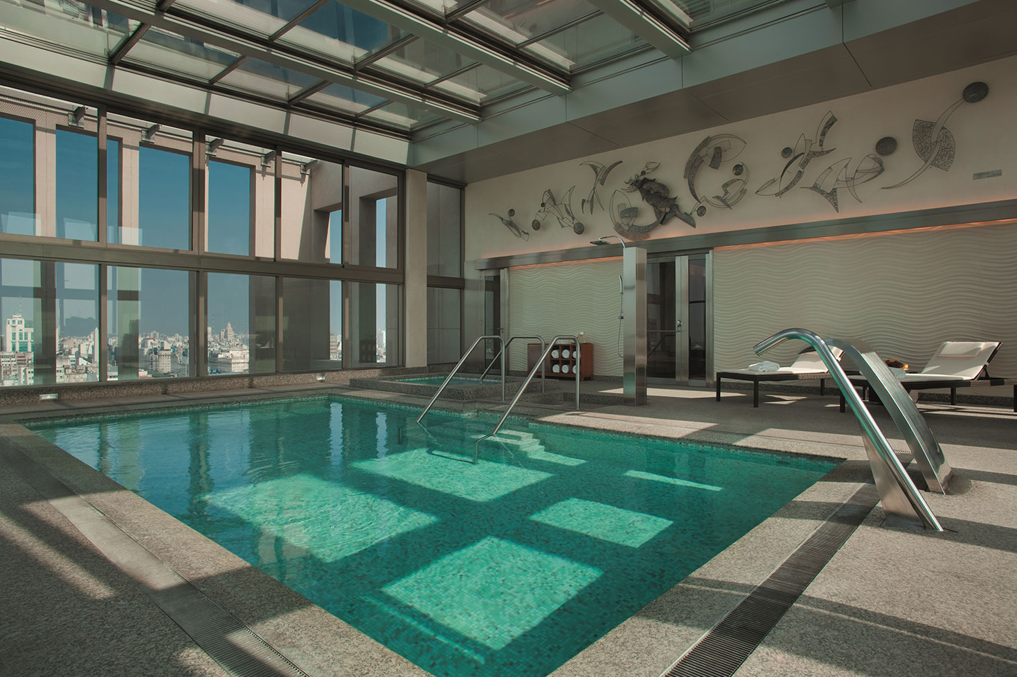 Hotel pool with people  Alvear Art Hotel, Luxury Hotel in Buenos Aires Downtown